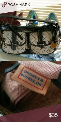 ☆☆24 hr SALE $20☆☆Dooney Bourke DBL POCKET Dooney Bourke dbl front pocket purse. So snazzy with it's signature monogram and silver hardware! Exc condition! 12 x 6in Dooney & Bourke Bags Shoulder Bags