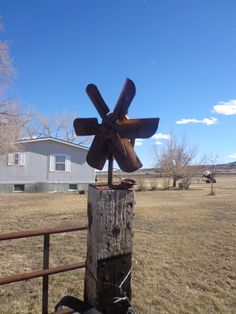 Old water pump makes pretty cool windmill.