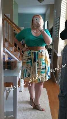 Perfect T tucked into a Madison skirt with a belt over top.  Photo of Plus Size LuLaRoe Jordan Denton