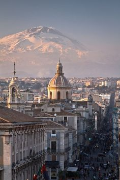 Catania, Sicily. City and Etna volcano. I want to go see this place one day. Please check out my website thanks. www.photopix.co.nz