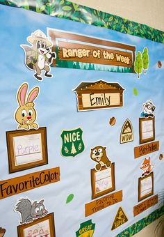 """Ranger Rick Ranger of the Week Mini Bulletin Board Display - Celebrate the student of the week with Ranger Rick and his friends. The set includes 1 """"Ranger of the Week"""" title piece, 6 character pieces, 1 blank header piece, 5 labels, 5 frames, 4 signs and 25 forest-themed accents, 47 pieces total."""