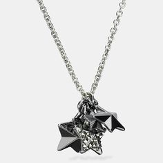 A pretty cluster of dimensional, mixed-metal stars adds playful charm to a delicate chain necklace. Glittering, hand-set pavé accents twinkle and catch the light.