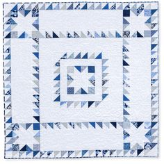Blue and white sawtooth star quilt, in:  Quilts Made with Love by Rachel Griffith - quilt book at Martingale
