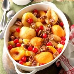 Home-for-Christmas Fruit Bake Recipe -Pop this special dish in the oven and mouths will water in anticipation— the cinnamony aroma is tantalizing! The fruit comes out tender and slightly tart while the pecan halves add a delightful crunch.