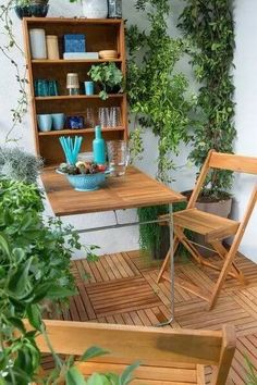 drop-down wooden patio table with storage shelves behind.