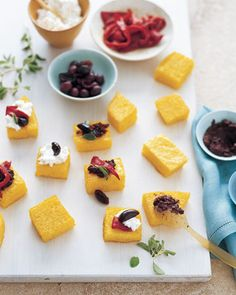 Just one example of how leftover polenta can be put to use, these garnished squares are an easy, casual snack or hors d'oeuvre. When baked, the pieces develop a crisp surface but retain their creamy center. For more detailed instructions, see our how-to.
