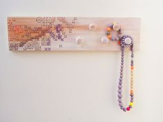 Cross Stitch Decor Whitewashed Upcycled Wooden Wall Rack 5 Knobs. €49,00, via Etsy.