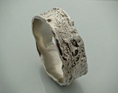 Molten texture sterling silver bangle