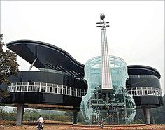 Piano Building.  Built in An Hui Province in China, this building is one of the world's most beautiful structures.    The escalator to the building is built inside the violin. The building has the city's development plans on display.
