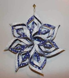 Free Fabric Snowflake Tutorial - Make a no-sew Fabric Snowflake. This is our finished inch version, blue & white. Decorate for the holidays with these beautiful fabric snowflakes! Diy Christmas Snowflakes, Folded Fabric Ornaments, Quilted Christmas Ornaments, Christmas Crafts To Make, Snowflake Craft, Christmas Sewing, Snowflake Ornaments, Christmas Decorations To Make, Holiday Crafts