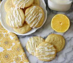 Lemon Sugar Cookies with Lemon Glaze - A light, buttery thin, lemon flavored cookie that is drizzled with a lemon glaze.