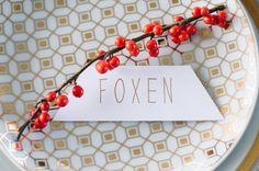 berry twig placecard - photo by Sean Money + Elizabeth Fay, event design by A Charleston Bride - http://ruffledblog.com/ruffled_galleries/bold-gold-charleston-wedding-ideas/bold-gold-charleston-wedding-ideas-027/