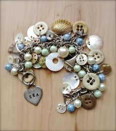 Vintage Love of the Sea Charm Bracelet - Repurposed Vintage Jewelry - Button Jewelry - Charm Bracelets - Vintage Jewelry - Sea Inspired. $48.00, via Etsy.