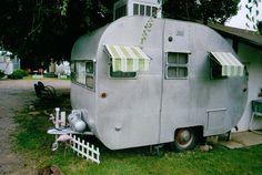 small metal caravan and buildings
