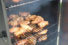 Racks of wings cooking low and slow.