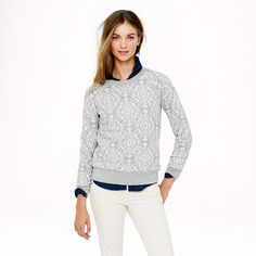 J.Crew - Medallion sweatshirt Love the sweatshirt, but especially like combo of grey sweatshirt over dark button down with light bottoms. I think the sweatshirt needs light colored embellishment though, to tie it together.