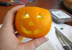 Scented Jack O Lantern Tea Lights made from oranges!  Bet this makes the house smell wonderful!  Easy tutorial!
