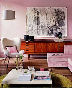Love this pale pink wall with the soft brown floor. The off white accents in the room give it a classic feel
