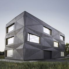 Tillich Architektur adds folded concrete facade  to textile company headquarters