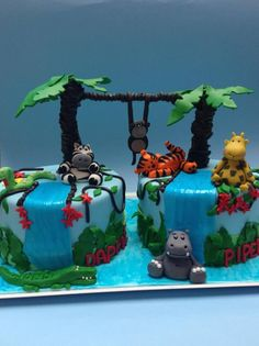 Safari themed cakes - Two cakes for two little four year olds who were having a safari themed party. The palm trees were put on sticks and the leaves on floral wire as is the rope between the trees. All animals made out of fondant~Love this!!! So cute!