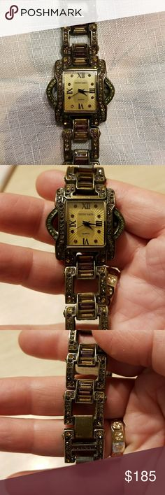 Heidi Daus ladies watch Antique style art deco ladies link style watch. Encrusted with gold, Amber, and light green crystals. Gently worn, brand new battery. No box. Heidi Daus Jewelry