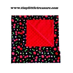 Baby Girl blanket $39.95. Black with cherries and flowers on the outside, bordered with the outside fabric and lined with bright red minky dot on the inside. 90cm x 90cm. Made with Cotton and minky dot fabric. You can purchase this product from www.tinylittletreasure.com