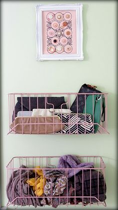 Attach baskets to the closet's inside wall or door to store small items like clutches, scarves, and gloves.
