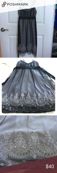 Beautiful beaded dress Hate letting go of this one! The beading on this dress is so beautiful. Spaghetti strap with detail (see picture). Satin black tie around waist. The detail at the bottom of the dress is so eye catching. Perfect for any special event. Dresses Mini