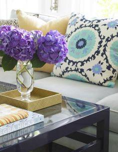 suzani pillow looks beautiful with the purple hydrangeas