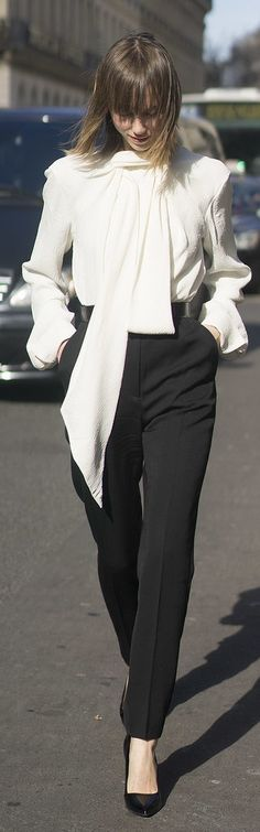Paris Fashion Week street style: Anya Ziourova wearing classic black pants and a white tie collar shirt paired with classic black pumps
