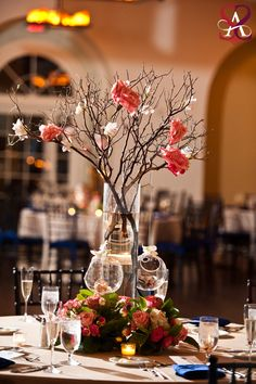 love the twigs for centerpieces with some bright flowers for color