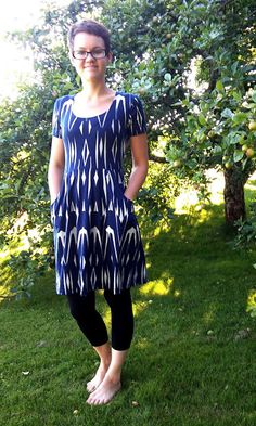 Tribal-style swallows. Pleated dress with BIG pockets.