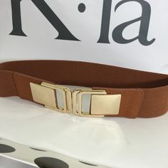 NWT - fashion belt NWT - fashion belt - golden buckle with leather accent and burnt orange elastic band - New Accessories Belts