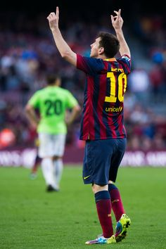 Lionel Messi of FC Barcelona celebrates after scoring his team's sixth goal during the La Liga match between FC Barcelona and CA Osasuna at Camp Nou on March 16, 2014 in Barcelona, Catalonia.