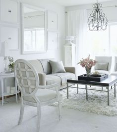 white living room - love the modern with antique, shaggy rug, mirrored art display