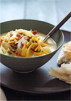 Slow-Cooker Loaded Baked Potato Soup -- Here's everything that's delicious in a loaded baked potato--cheese, bacon, sour cream--all in one easy slow-cooker soup recipe.