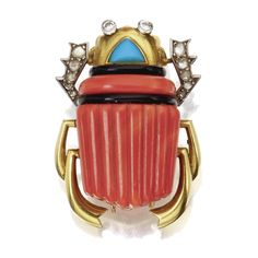 CORAL, TURQUOISE, DIAMOND AND ENAMEL SCARAB CLIP-BROOCH, CARTIER, PARIS, CIRCA 1945 Set with carved coral segments, a triangular-shaped cabochon turquoise, and rose-cut and single-cut diamonds, accented by black enamel