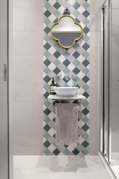 """There were so many decisions that when it came to the bathroom, the couple each chose what really mattered to them. """"My boyfriend wanted the biggest rainfall shower heads possible, and I wanted pretty tiles. The ones in the shower room are from Fired Earth and the hexagons on the ensuite floor are from Mandarin Stone (inspired by Soho House in Miami)."""""""