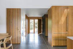 SHED Architecture & Design's ranch-style house remodel project in Seattle's Madison Park featuring a new kitchen, bath and modern exterior. Mid Century Ranch, Mid Century House, Foyers, Modern Foyer, Modern Living, Estilo Interior, Ikea, Ranch Style Homes, Software