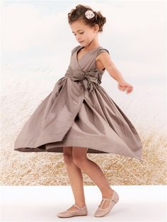 Bow dress for girl by French retailer Cyrillus