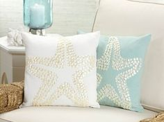 These sea-inspired pillows are lovely and the detail makes it look almost made of shells.