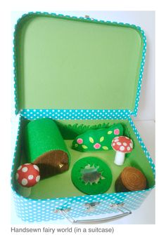 Fairy small world in a suitcase
