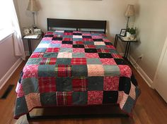 This beautiful quilt is made with Denim and Flannelette squares. It is a Patchwork Design with squares on the diagonal. There are different colours of denim, with plaid and and Fuchsia squares intermixed. The backing is a White Flannelette. It is made to fit a Queen size bed. It has Extra Warm batting inside. Will keep you nice and toasty. Would make a very lovely Housewarming Ggift or special gift to someone convalescing. Also makes a great Christmas Gift, Mothers Day, Fathers Day…