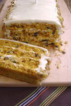 "Recipe | Classic Carrot Cake :: ""Beneath this towering yet unpretentious appearance lies multiple layers of moist, mildly spiced cake that are flecked with carrots and pecans and enveloped by a generous coating of cream cheese frosting.""—Martha Stewart"