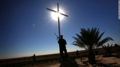 A member of the Babylon Brigades, an Iraqi Christian militia, stands guard at a monastery in the town of Khidr Ilyas, southeast of Mosul, on November 22.