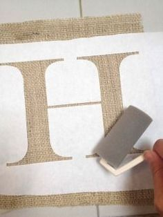 Little Birdie Secrets: burlap and paper wedding banners {tutorial} How to use freezer paper and paint to print on burlap....also cute coffee filter flowers.