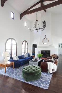 This beautiful Spanish home I designed for a client in Southern California featured white walls everywhere and dark, rich wood floors. We wanted to keep the walls white to stay in keeping with the Spanish Revival style of the home, so we brought in color with the sofa and the rug. The sofa, in particular, was a vintage piece we found at an antique store and I had it custom upholstered in that rich indigo velvet that you can literally melt into a la Rose in the Titanic.