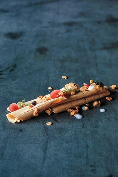The sticks here are curls of foie gras; the droplets vanilla puree, compressed apple, and apple puree.