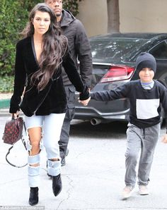 Busy mom: Kourtney held onto her oldest child's hand as they ran errands. Her other two children whom she shares with on off love Scott Disick weren't spotted on the outing