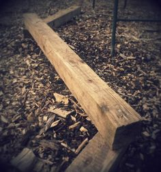 Reclaimed fence posts recycled into a balance beam for kids garden play area.